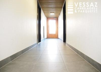 Rénovation d'un couloir d'entrée de bâtiment à Avenches